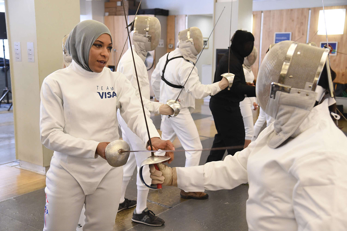 FILE - In this June 2, 2016, file photo, Team Visa athlete Ibtihaj Muhammad leads an interactive fencing demonstration in New York. This year more than ever, the so-called ``face'' of the Olympics could be a wrestler, or a fencer, or an athlete who most of the world has never heard of before. Visa, an Olympic sponsor for the past three decades, has a long list of the well-known _ Walsh-Jennings, Franklin, Carli Lloyd _ along with those who are not yet household names. Namely, Muhammad, the Muslim fencer who chose her sport in part because it allowed her to compete while wearing a hijab. (AP Photo/Charles Sykes, File)/NY152/16172531095986/SPCL THIS PHOTOGRAPH WAS TAKEN BY AP IMAGES FOR VISA/1606201816